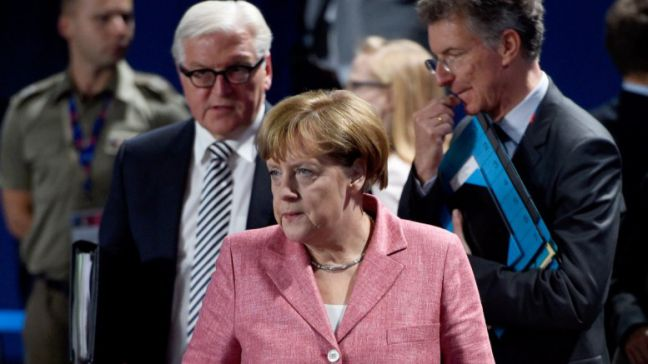 German chancellor Angela Merkel (C), her advisor for foreign and security policy, Christoph Heusgen (R), and foreign minister Frank-Walter Steinmeier (L). EPA, RAINER JENSEN