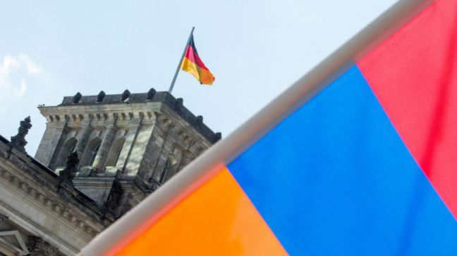 An Armenian flag in front of the Reichstag building in Berlin, Germany, 02 June 2016. The German Bundestag adopted a resolution to name the 1915/16 massacre of the Armeinians by the Ottoman Empire as genocide. Turkey, the legal successor of the Ottoman Empire, had cautioned against the acceptance of the resolution. EPA, ALEXANDER HEINL